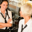 Waitresses talking gossiping in break cafe women — Стоковое фото
