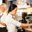Стоковое фото: Staff at cafe making coffee espresso machine