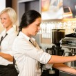 Staff at cafe making coffee espresso machine — ストック写真