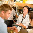Stockfoto: Couple paying bill at cafe cash desk
