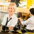 Waitress serving coffee cups making espresso woman — Stockfoto #12729277