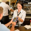 Foto de Stock  : Mpaying bill at cafe using card