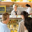 Stock Photo: Customers waiting in line to buy dessert