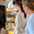 Customers waiting in line to buy dessert — Stock Photo #12729290
