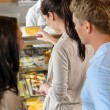 Customers waiting in line to buy dessert - Stock Photo