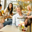 Grandmother and grandchild waiting cake order cafe — Stock Photo