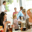 Women friends enjoying a drink at cafe — Stock Photo