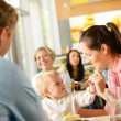 Royalty-Free Stock Photo: Father and mother feeding child cake cafe