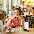 Stock Photo: Senior woman with her daughter at cafe