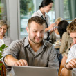 Men business partners working on laptop cafe — Stock Photo #12729339