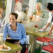 Stock Photo: Businesswomworking in lunch break in cafe
