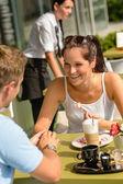 Couple enjoy coffee dessert restaurant terrace — Stock Photo