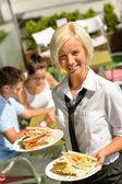 Waitress bringing sandwiches on plates fresh lunch — Stock Photo