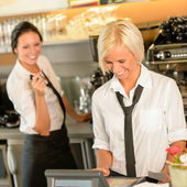 Cafe waitress cashes in order bill register — Stock Photo