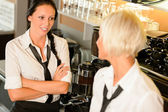 Waitresses talking gossiping in break cafe women — Stock Photo