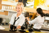 Waitress serving coffee cups making espresso woman — Stock Photo