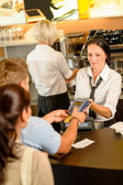 Man paying bill at cafe using card — Stock Photo