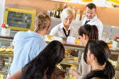 Buying cakes at cafeteria queue desserts — Stock Photo
