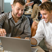 Men business partners working on laptop cafe — Stock Photo