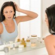 Woman look at herself bathroom mirror reflection — Stock Photo #12816081