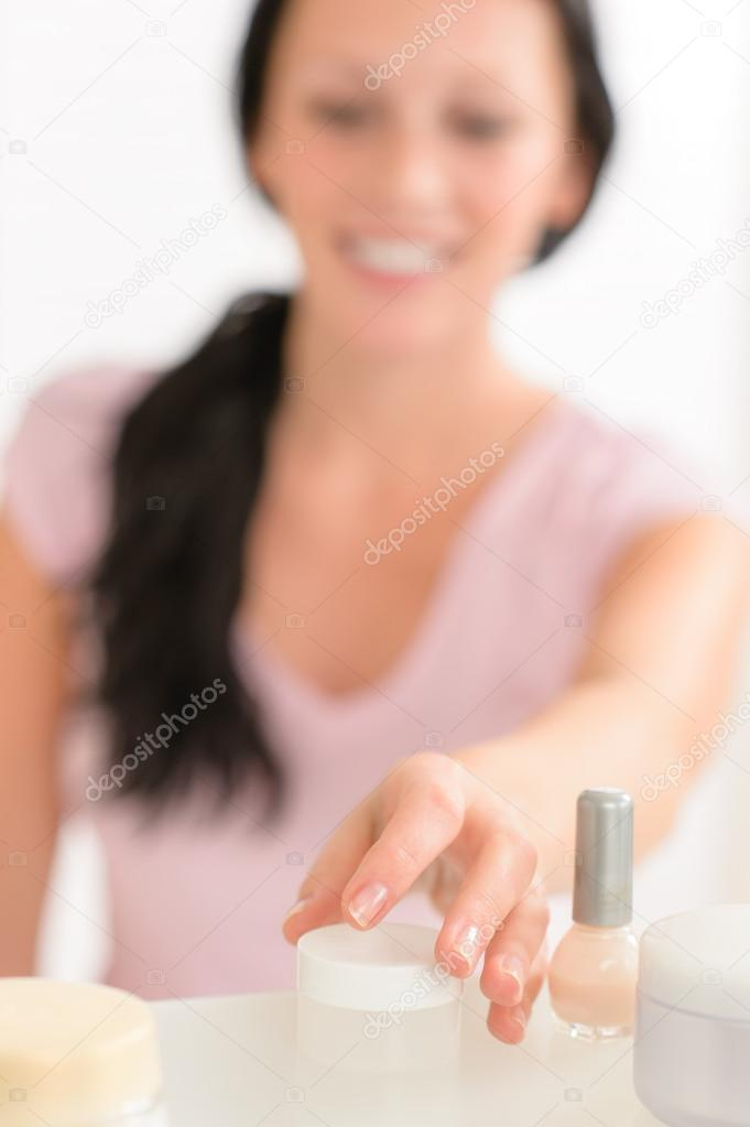 Close-up beauty nail care products in bathroom woman in background  Stock Photo #12816254