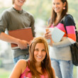 Back to school students studying in library — Stock Photo