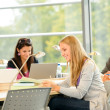 High- school students studying in library together - Stock Photo