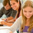 Teens study in high-school library reading student — Stock Photo