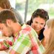 Pupils gossiping behind colleague&#039;s back in school - Stockfoto