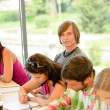 High-school students at lesson in class teens — Stock Photo #12925080