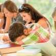 High-school student falling asleep in class teens - Stock Photo