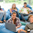 Students sitting on beanbags in study room in study room — Stock Photo