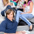 Students sitting on high-school stairs in break — Stock Photo