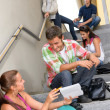 Students talking relaxing on school steps teens — Stock Photo #12925813