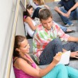 Stock Photo: Students talking relaxing on school steps teens