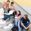 Students having fun with laptop school stairs — Foto Stock