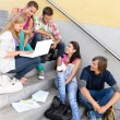 Students having fun with laptop school stairs - Stock Photo