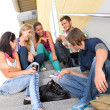 Students laughing on school stairs in break — Stock Photo