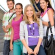 Students back to school on college stairs - Stock Photo