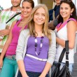 Students back to school on college stairs — Stock Photo