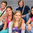 Students sitting on school stairs smiling teens — Stock Photo