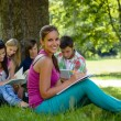 Students studying on meadow in park teens — Foto Stock