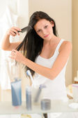Bathroom woman comb hair in front mirror — Stock Photo