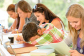 High-school student falling asleep in class teens — Stock Photo