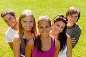 Teens relaxing in the park friends happy — Foto Stock