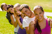 Students enjoying a break in the park — Stock Photo