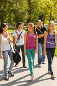 Students walking to school teens happy campus — Stock Photo