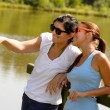 Daughter and mother relaxing on lake pier — Stock Photo #13248629