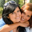 Stock Photo: Daughter hugging her mother outdoors happy loving