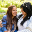 Mother and daughter smiling at each other — Stock Photo #13248512